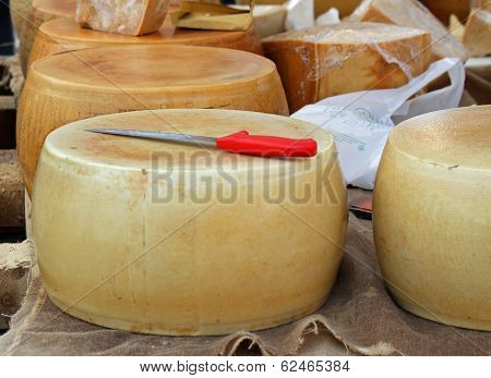 Yellow Cheese On Sale From Milkman Into A Village Fair