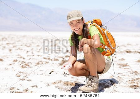 Death Valley. Hiker woman in Death Valley, California, USA showing dried out salt in Badwater Basin