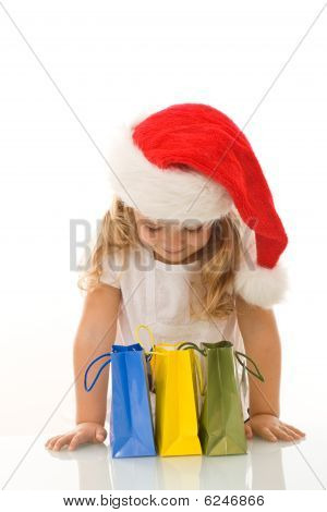 Little Girl Checking The Presents