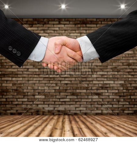 busines man handshake with modern interior background