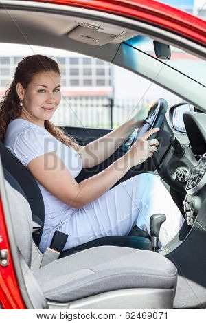 Attractive Woman Through The Opened Door Sitting In Red Car