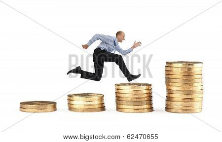 Businessman Running Over Coin Stack