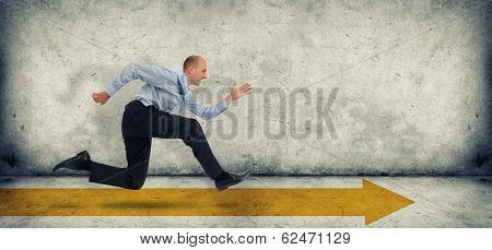 Business Man Run On Yellow Arrow