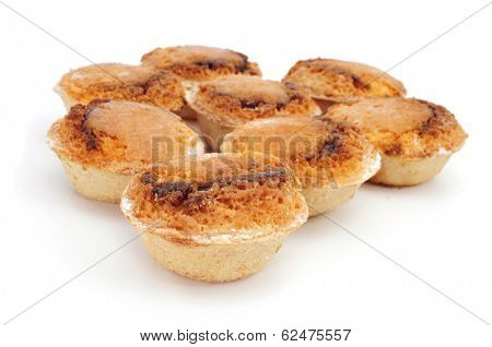 some pasteis de feijao typical Portuguese pastries, on a white background