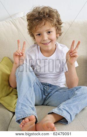 young boy sitting on a sofa