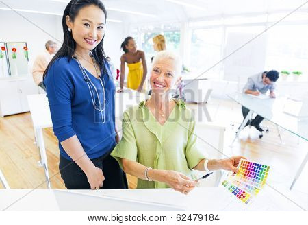 Designers Choosing Colors From a Color Swatch