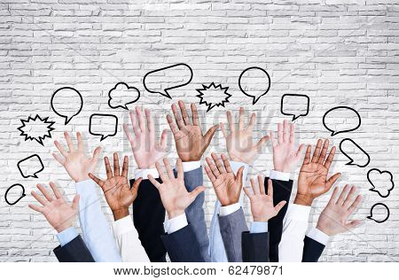 Business People's Hands Raised