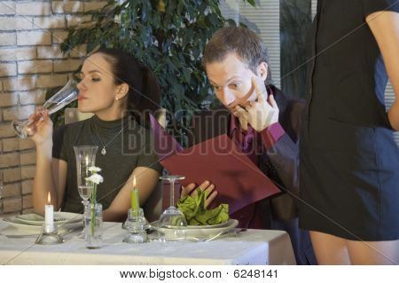 Surprised Man With Bill In Restaurant