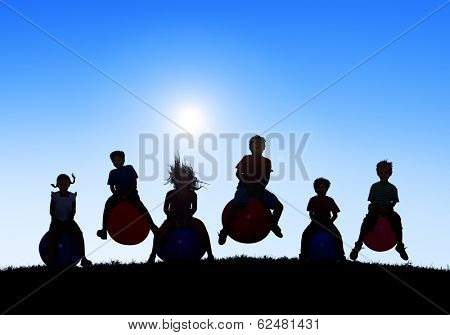 Silhouettes of Children Playing on Bouncy Balls