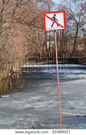 Do Not Walk Sign On Frozen River In Spring
