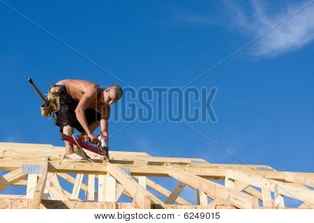 Carpenter Using Nail Gun