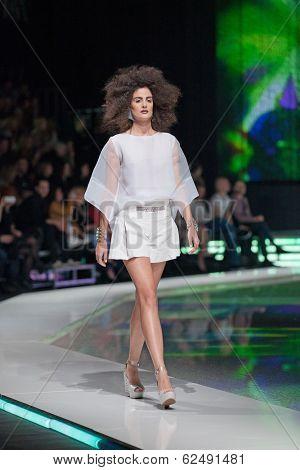 ZAGREB, CROATIA - MARCH 28, 2014: Fashion model wearing clothes designed by Marina Design and Marija Ivanovic bracelets on the 'Fashion.hr' fashion show