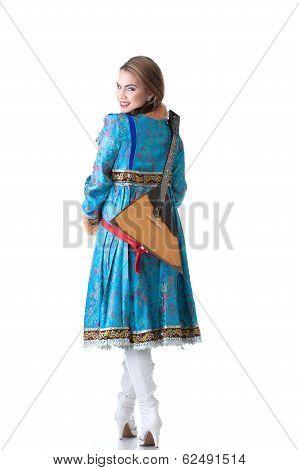 Cheerful Russian girl posing with balalaika