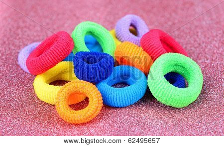 Colorful scrunchies on pink background
