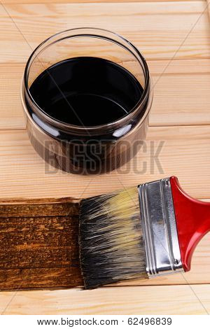 Applying protective varnish to wooden board close-up