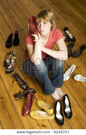 Young Woman Choosing Shoes