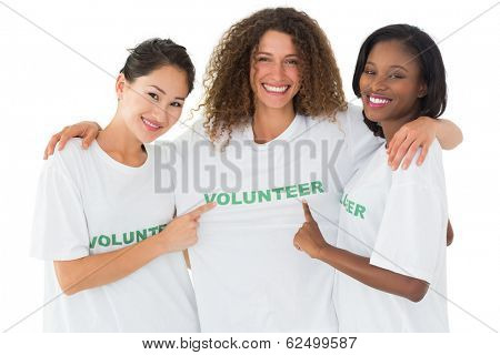 Attractive team of volunteers smiling at camera on white background