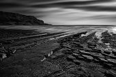 pic of cloud formation  - Stunning black and white seascape coastline and rocky shore at sunset - JPG