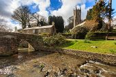 stock photo of church-of-england  - The Church of St Nonna and Pack Horse bridge at Altarnun on Bodmin Moor Cornwall England UK Europe - JPG