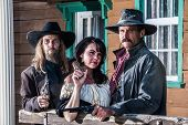 stock photo of threesome  - A Portrait of three old west citizens - JPG
