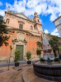 stock photo of tomas  - Valencia Santo Tomas church in plaza san Vicente Ferrer with fountain at Spain - JPG