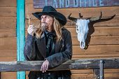 pic of bandit  - Portrait of a gruff looking old west bandit - JPG