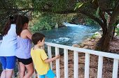 stock photo of israel people  - Sisters and Brother watching the Jorden River  - JPG