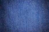 stock photo of indigo  - close up dark blue denim jean texture background - JPG