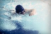 picture of swim meet  - Professional male swimmer swimming in the pool