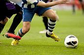 picture of leggings  - Legs of two soccer players vie on a match - JPG
