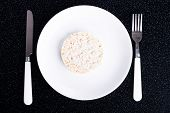 One rice waffle on a white plate.