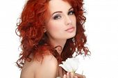 beautiful young redheaded girl with white tulips, isolated on a white background