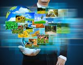 Businessman Holding Green Earth In Hands And Reaching Images Streaming .environmental Concept
