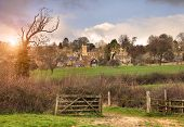 stock photo of marshes  - The pretty North Cotswold village of Bourton - JPG