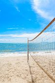 picture of volleyball  - beach volleyball net on the beach with blue sky - JPG