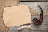 image of tobacco-pipe  - Paper piece for copy space and tobacco pipe on wooden background - JPG