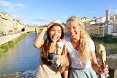 pic of gelato  - Happy women friends eating ice cream on travel in Florence - JPG