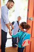 stock photo of say goodbye  - Father Saying Goodbye To Children As They Leave For School - JPG