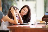 picture of 13 year old  - Mother Helping Stressed Teenage Daughter Looking At Laptop - JPG