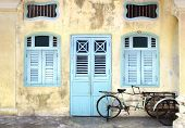 image of rickshaw  - Rickshaw on the background of a traditional house - JPG