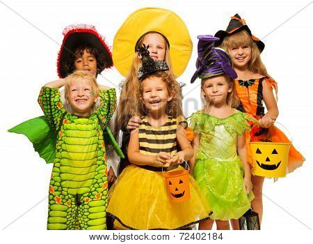 Many kids in Halloween costumes, boys and girls