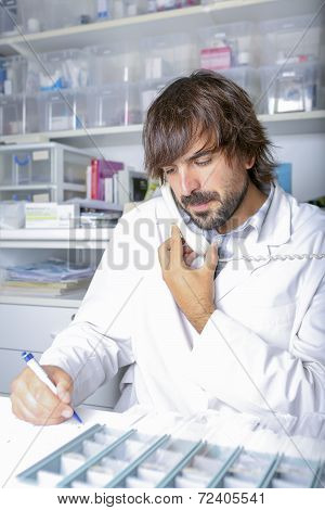 Pharmacist Talking On The Phone