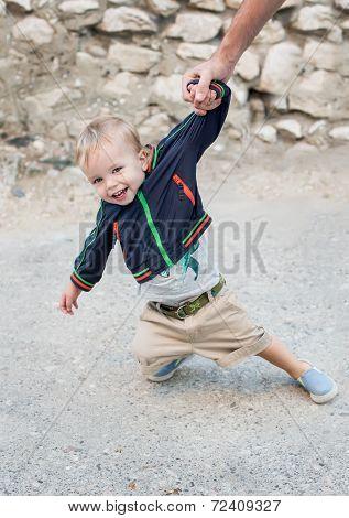 Toddler Cute Boy On The Walk