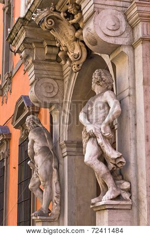 Sculptures on old prefecture building at downtown of Parma