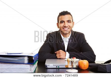 Manager Sitting At Desk