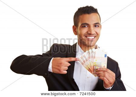 Manager Pointing To Banknotes