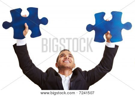 Manager Holding Big Jigsaw Pieces