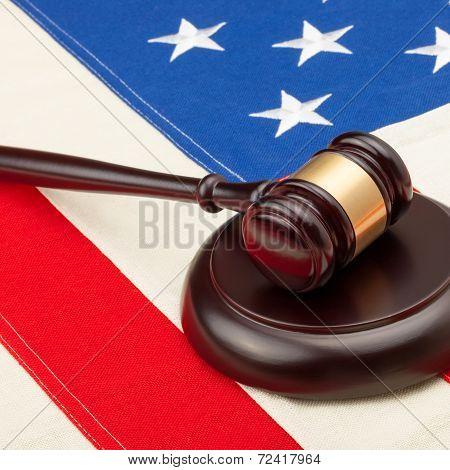 Wooden Judge Gavel And Soundboard Laying Over Usa Flag - Closeup Shot