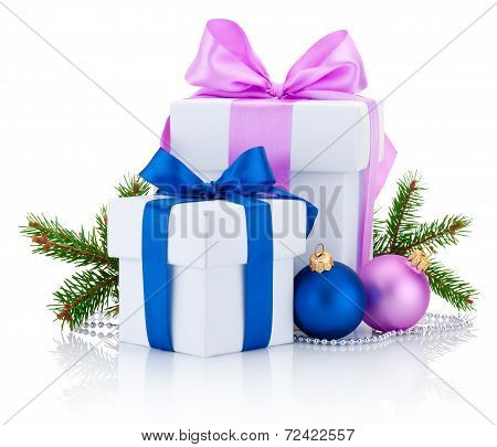 Two White Boxs Tied Pink And Blue Ribbon Bow, Pine Tree Branch And Christmas Balls Isolated On White