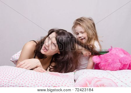 My Mother Is Very Sick. Daughter Combing Her Hair